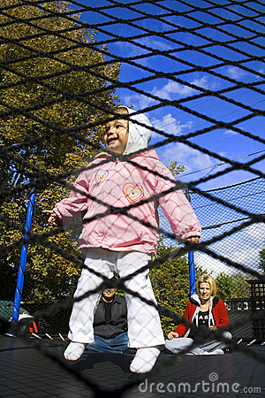 Family on the Trampoline Playing