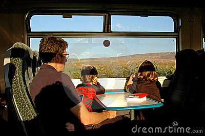 Family travelling on a train