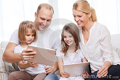 Family and two kids with tablet pc computers