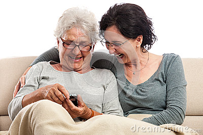 Family two women laughing with cell phone