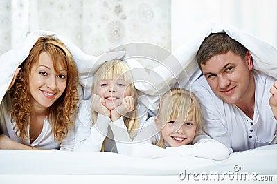 Family under blanket