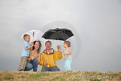 Family under umbrellas