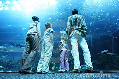 Family in underwater aquarium tunnel