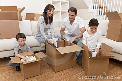 Family Unpacking Boxes Moving House