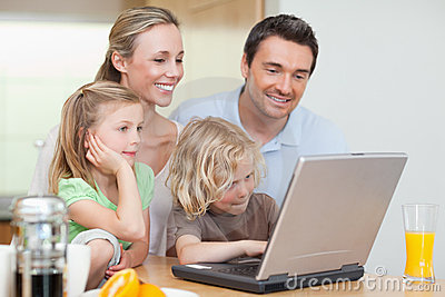 Family using the internet in the kitchen