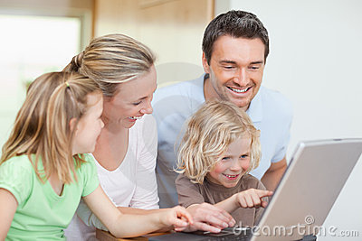 Family using notebook in the kitchen