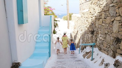 Family vacation in Europe. Mother and little girl in european vacation in greek town. Family vacation in Europe. Mother and kids at street of typical greek stock footage