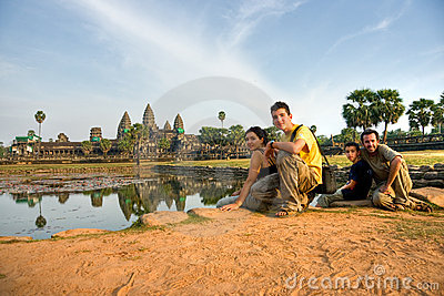 Family visiting Angkor Wat at sunset, cambodia.