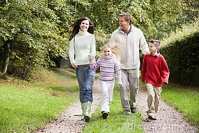 Family on walk through countryside