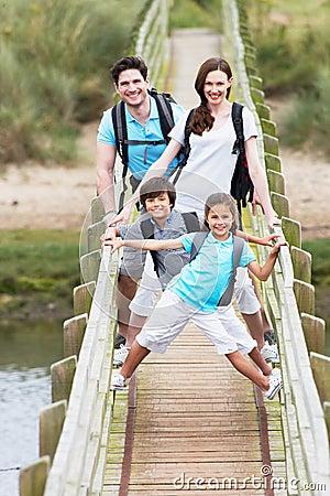Free Family Walking Along Wooden Bridge Royalty Free Stock Photo - 33088465