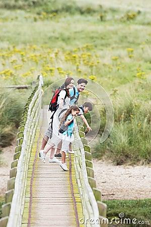 Free Family Walking Along Wooden Bridge Stock Image - 33088781