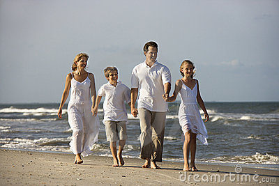 Family walking at beach.
