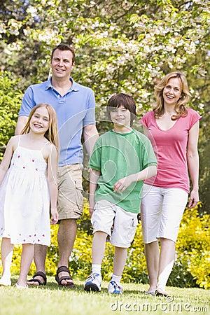 Family walking outdoors smiling