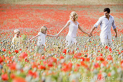 Family Walking Through Poppy Field Royalty Free Stock Photo - Image: 4833035