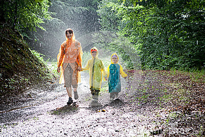 Family walking in the rain