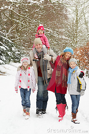 Free Family Walking Through Snowy Woodland Stock Photography - 12988732