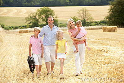 Family Walking Together Through Summer Harvested F