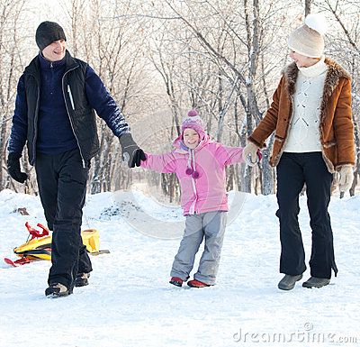 Family walking in a winter park