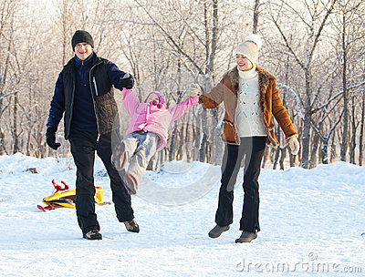 Family walking in a winter park