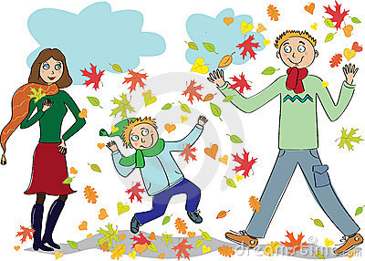Family walks in the autumn park