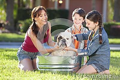 Family Washing Pet Dog In A Tin Bath Tub
