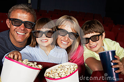 Family Watching 3D Film In Cinema