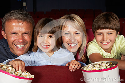 Family Watching Film In Cinema