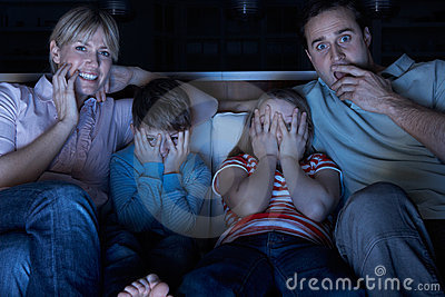 Family Watching Scary Programme On TV