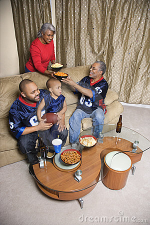 Family watching sports on tv.