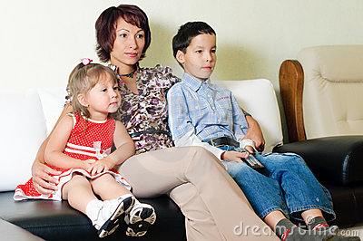 A family watching  a tv