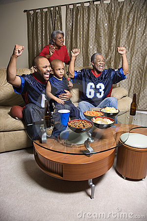 Free Family Watching TV Cheering Royalty Free Stock Images - 2043819