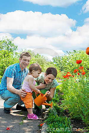 Free Family Watering Flowers Royalty Free Stock Image - 9764236