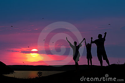 family welcomes the sunset sun