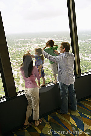 Family at window.