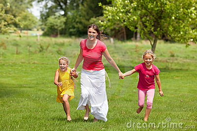 Family woman and girls running outdoor smiling