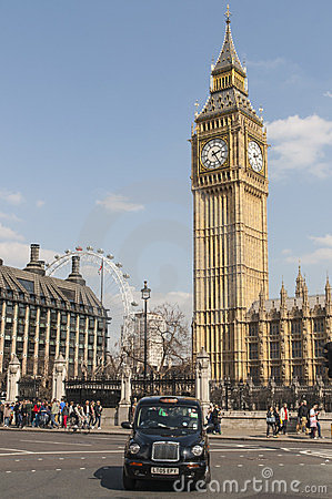 Famous black cab driving by Houses of Parliament Editorial Stock Photo