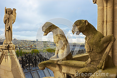 Famous gargoyles and angel of Notre Dame