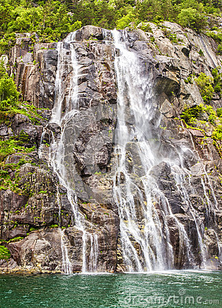 Free Famous Hengjanefossen Waterfall Coming Down From A Steep Rock Face Into Lysefjord. Royalty Free Stock Image - 61268936