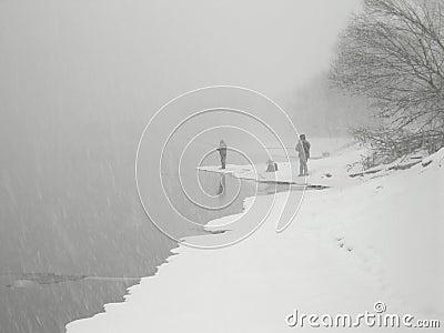 Fanatic anglers fishing in heavy snowfall