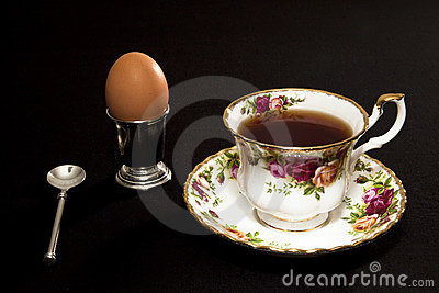Fancy coffee cup and egg