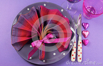 Fancy pink and purple table setting with fan shape napkin - aerial