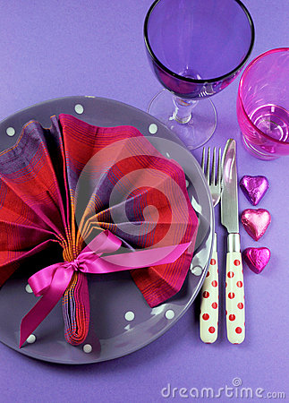Fancy pink and purple table setting with fan shape napkin - vertical.