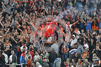 Fans burn fireworks in the stands Editorial Image