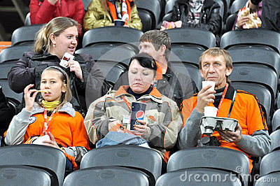 Fans with fast food on the sector before the match Editorial Stock Photo