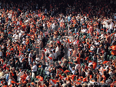 Fans wave orange rags and cheer before game Editorial Stock Photo