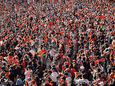 Fans wave orange rags and cheer to rally team Editorial Stock Image