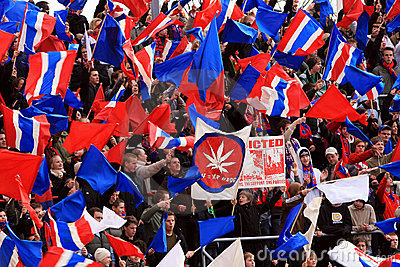 Fans waving flags at football game Editorial Stock Photo