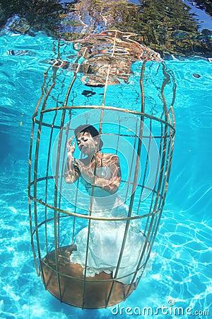 stock photo fantasy bride underwater bird cage diving lovely gorgeous wedding white dress sunny imag