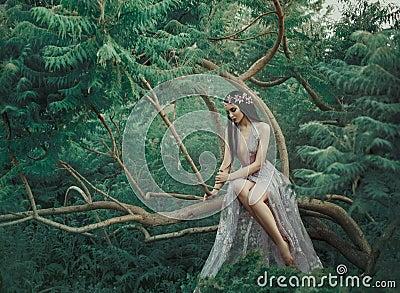 Fantasy girl in a fairy garden. Stock Photo