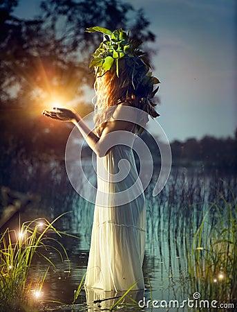 Free Fantasy Girl Taking Magic Light Stock Photo - 41395890